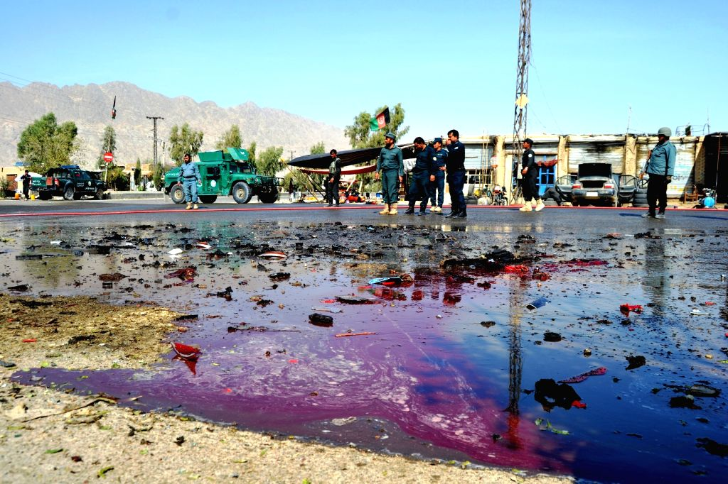 KANDAHAR, Oct. 29, 2016 - Afghan policemen inspect the site of a suicide attack in Kandahar province, Afghanistan, Oct. 29, 2016. A police officer was killed and three others injured in a suicide ...