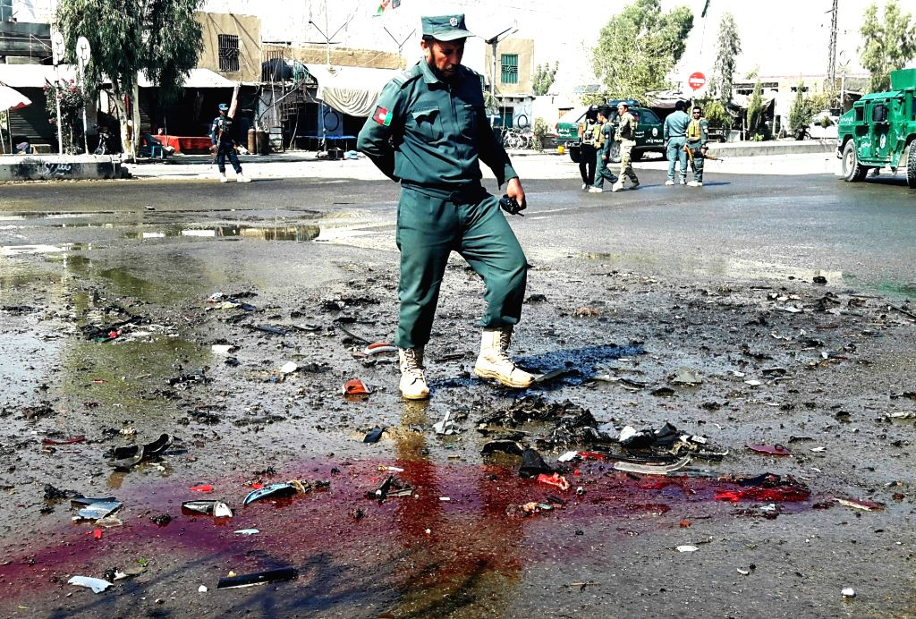 KANDAHAR, Oct. 29, 2016 - An Afghan policemen inspects the site of a suicide attack in Kandahar province, Afghanistan, Oct. 29, 2016. A police officer was killed and three others injured in a suicide ...