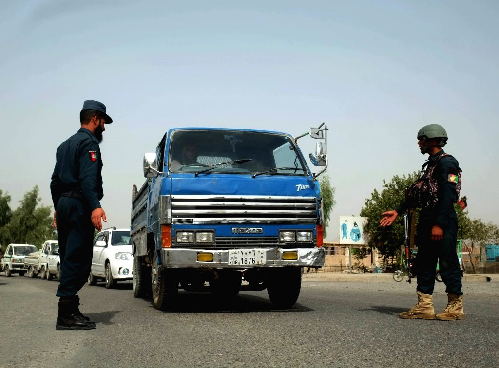 KANDAHAR, Sept. 16, 2018 - Afghan security force members stand at a security checkpoint in Kandahar city, capital of Kandahar province, Afghanistan, Sept. 16, 2018. Unknown armed militants gunned ...