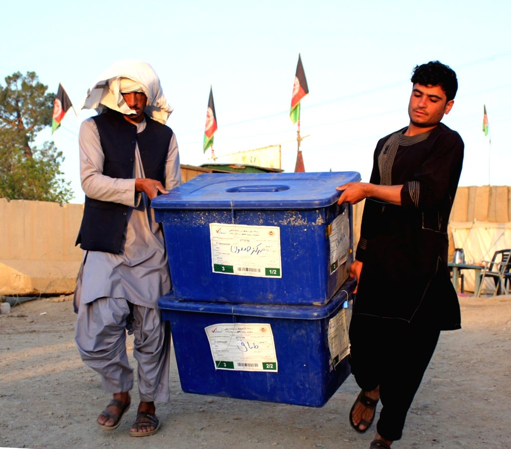 KANDAHAR, Sept. 22, 2019 - Staff members of Afghan Independent Election Commission(IEC) carry ballot boxes in Kandahar, Afghanistan, Sept. 21, 2019 . The country is preparing for the upcoming ...