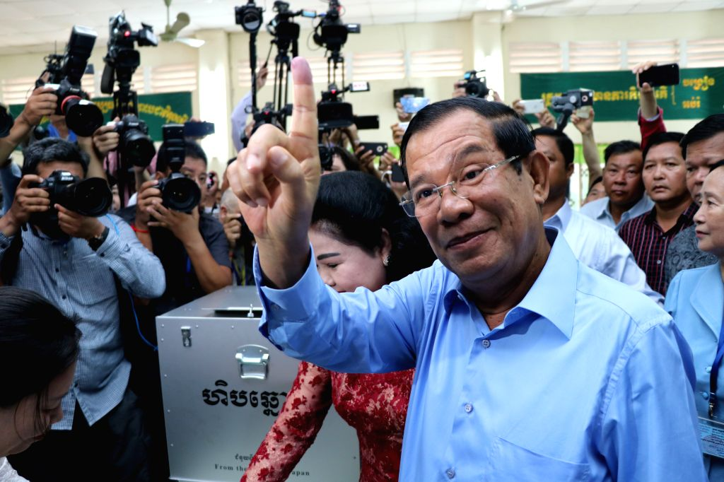 KANDAL, July 29, 2018 - Cambodian Prime Minister Samdech Techo Hun Sen gestures after casting his ballot at a polling station in Kandal province, about 15 km south of capital Phnom Penh, Cambodia, on ... - Samdech Techo Hun Sen