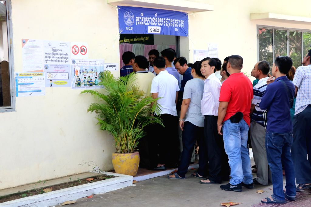 KANDAL, July 29, 2018 - Voters wait to cast their ballots at a polling station in Kandal, about 15 km south of capital Phnom Penh, Cambodia, on July 29, 2018. The sixth general election kicked off in ...