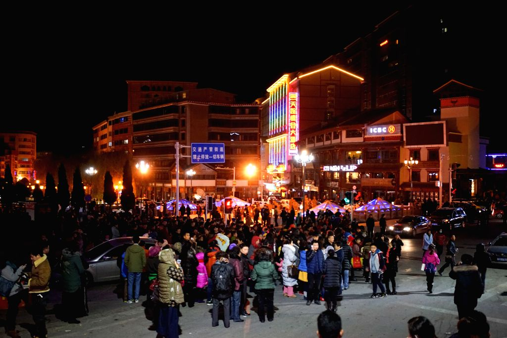 Kangding (China): Residents stand on the road to avoid the earthquake in Kangding County, southwest China's Sichuan Province, Nov. 25, 2014. A 5.8-magnitude earthquake struck Kangding County, Ganzi ..