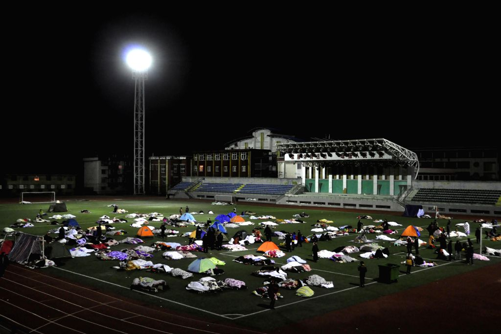 Kangding (China): Residents stay in a stadium to avoid earthquake in Kangding County, southwest China's Sichuan Province, Nov. 26, 2014. A 5.8-magnitude earthquake struck Kangding County at 11:19 ...