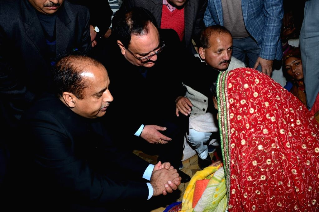 Kangra: Himachal Pradesh Chief Minister Jai Ram Thakur and Union Health Minister JP Nadda console the family of martyr Tilak Raj, who was among the 49 CRPF personnel killed in a suicide attack by militants in Jammu and Kashmir's Pulwama district on 1 - Jai Ram Thakur