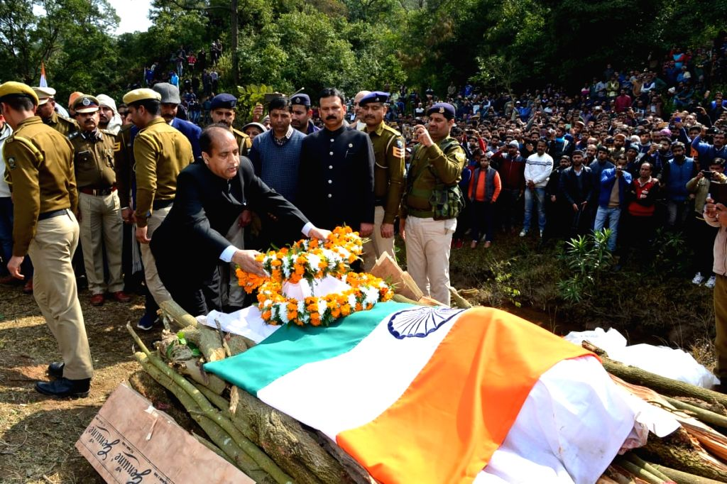Kangra: Himachal Pradesh Chief Minister Jai Ram Thakur pays his last respects to martyr Tilak Raj, who was among the 49 CRPF personnel killed in a suicide attack by militants in Jammu and Kashmir's Pulwama district on 14th Feb 2019; in Jandro village - Jai Ram Thakur