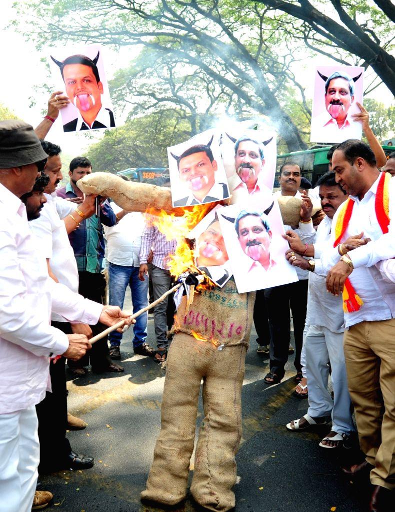 Kannada activists stage a protest against Maharashtra Chief Minister Devendra Fadnavis and Goa Chief Minister Manohar Parrikar over Mahadayi water project in Bengaluru on Jan 23, 2018. - Devendra Fadnavis