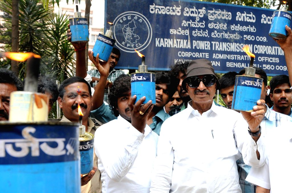 Kannada Chaluvali Vatal Paksha workers led by party's president Vatal Nagaraj demonstrate against hike in electricity charges holding kerosene lamps in Bangalore on April 24, 2014.