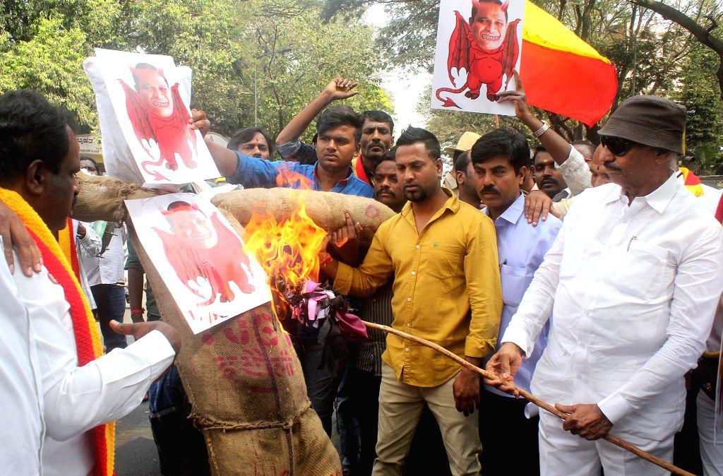 Kannada Rajya Okkuta and Kannada activists stage a demonstration against Goa's Water Resources Minister Vinod Palienkar over his controversial remarks in Bengaluru on Jan 16, 2018. ... - Vinod Palienkar