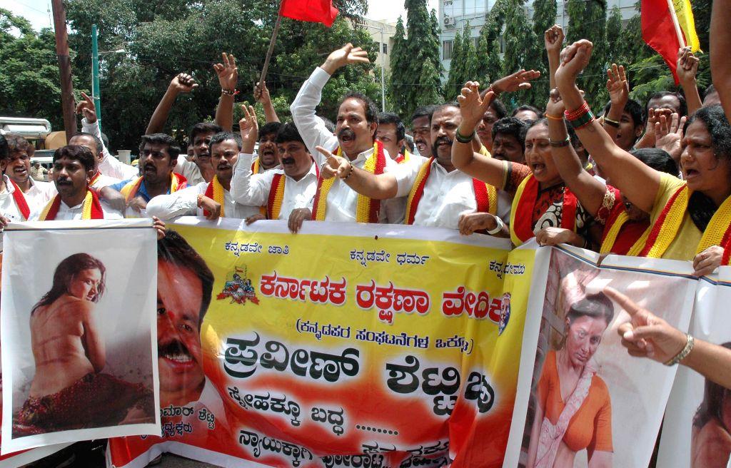 Kannada Rakshana Vedike activists led by their chief  Praveen Shetty demonstrate against the film `Abinetri` in Bangalore on Aug 14, 2014. - Praveen Shetty