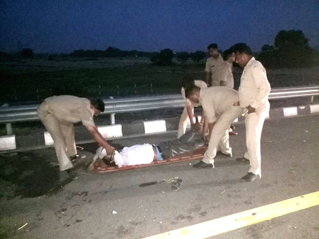 Kannauj: Police personnel take an injured to the hospital in Uttar Pradesh's Kannauj district on June 11, 2018. Seven students were killed and two others critically injured on Monday after they run over by a bus in Uttar Pradesh's Kannauj district. T