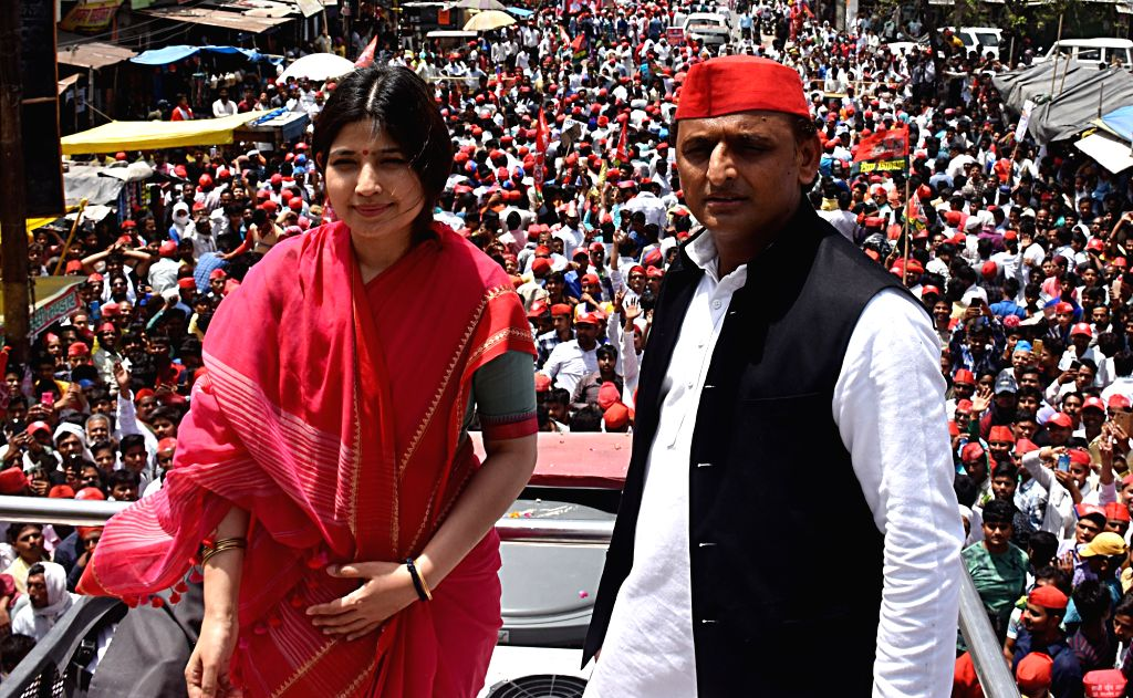 Kannauj: Samajwadi Party President Akhilesh Yadav with her wife and the party's Lok Sabha candidate from Kannauj Dimple Yadav during a roadshow ahead of the 2019 Lok Sabha elections in Uttar Pradesh's Kannauj on April 27, 2019. Kannauj is one of the  - Akhilesh Yadav and Kannauj Dimple Yadav