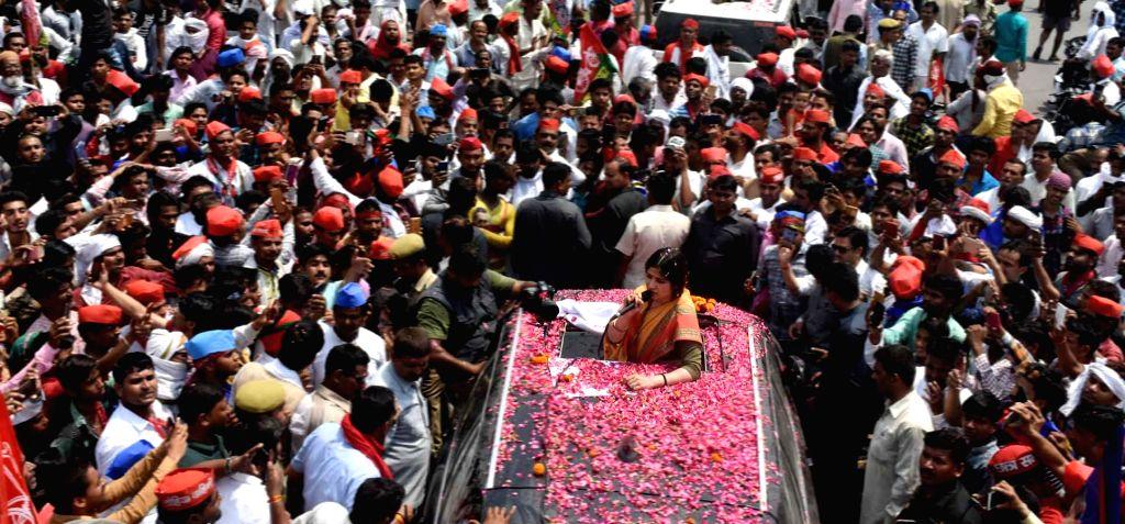 Kannauj: Samajwadi Party's Lok Sabha candidate from Kannauj, Dimple Yadav addresses a gathering during a roadshow ahead of the 2019 Lok Sabha elections, in Uttar Pradesh's Kannauj on April 24, 2019. (Photo: IANS) - Yadav