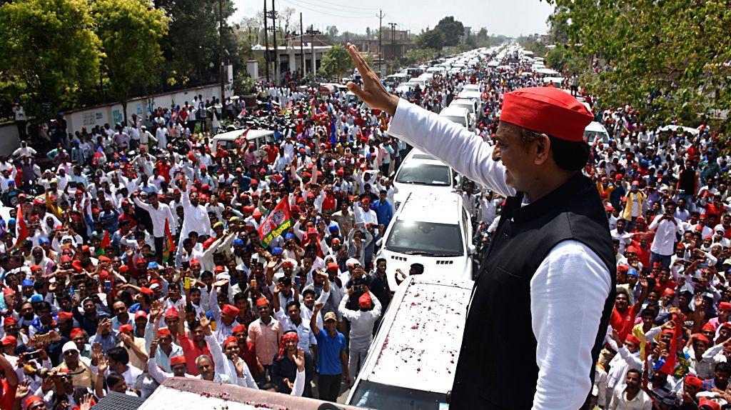 Kannauj: SP chief Akhilesh Yadav waves at supporters during a roadshow ahead of 2019 Lok Sabha elections, in Uttar Pradesh's Kannauj, on April 6, 2019. (Photo: IANS) - Akhilesh Yadav