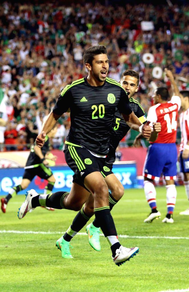 Mexico's Eduardo Herrera (front) celebrates his scoring with teammates during the international friendly match against Paraguay, in the Arrowhead Stadium in Kansas ...