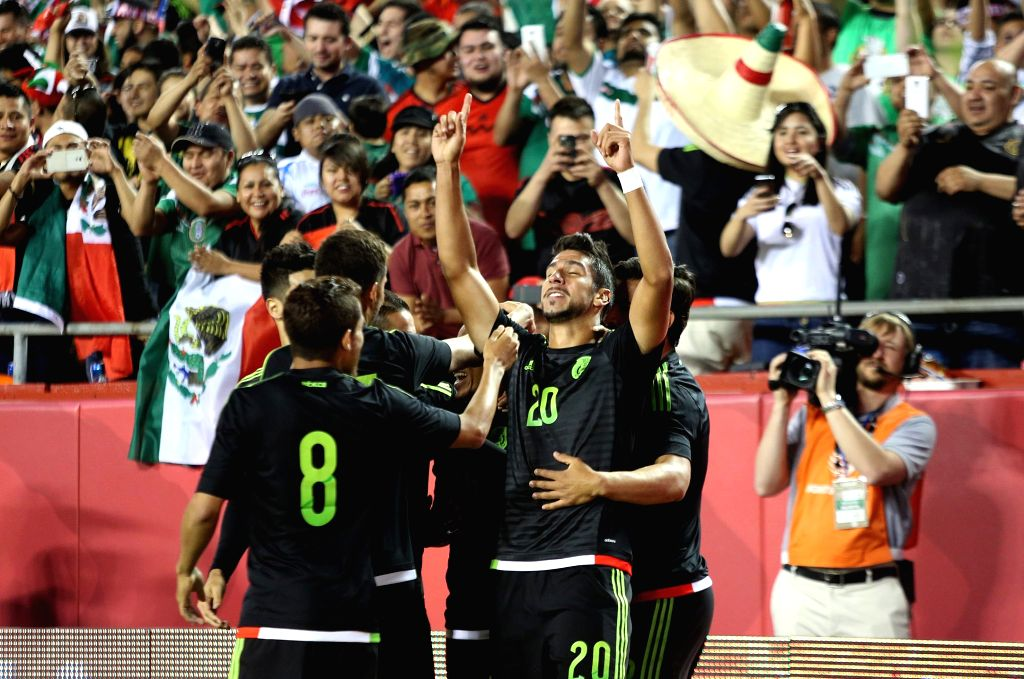 Mexico's Eduardo Herrera (R front) celebrates his scoring with teammates during the international friendly match against Paraguay, in the Arrowhead Stadium in Kansas ...
