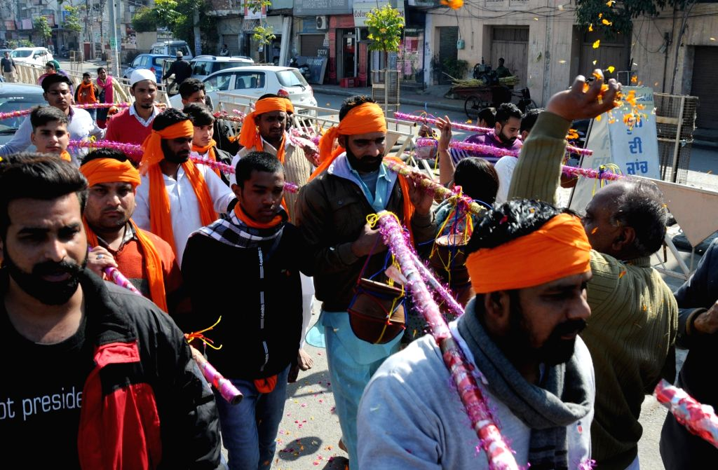 Kanwarias carry pots filled with holy water to be offered to Lord Shiva, on Maha Shivaratri in Amritsar on Feb 14, 2018.