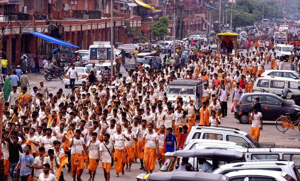 Kanwariyas - devotees - during their pilgrimage to worship Lord Shiva in the holy month of Shravan also known as Sawan, in Jaipur on July 28, 2019.