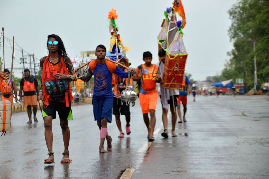 Kanwariyas - devotees - during their pilgrimage to worship Lord Shiva in the holy month of Shravan also known as Sawan, in Ghaziabad on July 28, 2019.