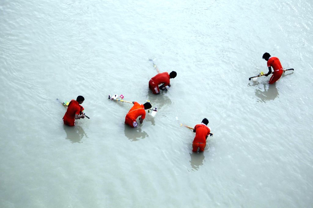 """Kanwariyas"""" -devotees of lord Shiva- collect holy Ganga water from Allahabad before heading for Kashi on July 31, 2016."""