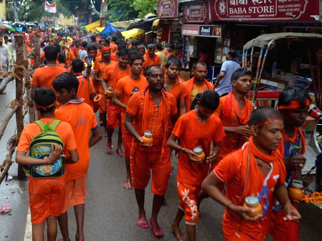 Kanwariyas - devotees - walk towards Kashi Vishwanath Temple in the holy month of Shravan also known as Sawan, in Varanasi, on July 29, 2018.
