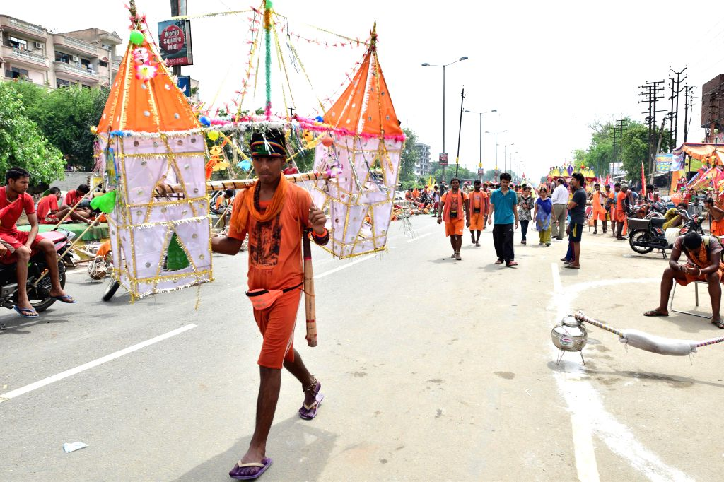 Kanwariyas (Shiva devotees) march on  G T Road in Ghaziabad with holy water of Ganga river in Ghaziabad on July 23, 2014.