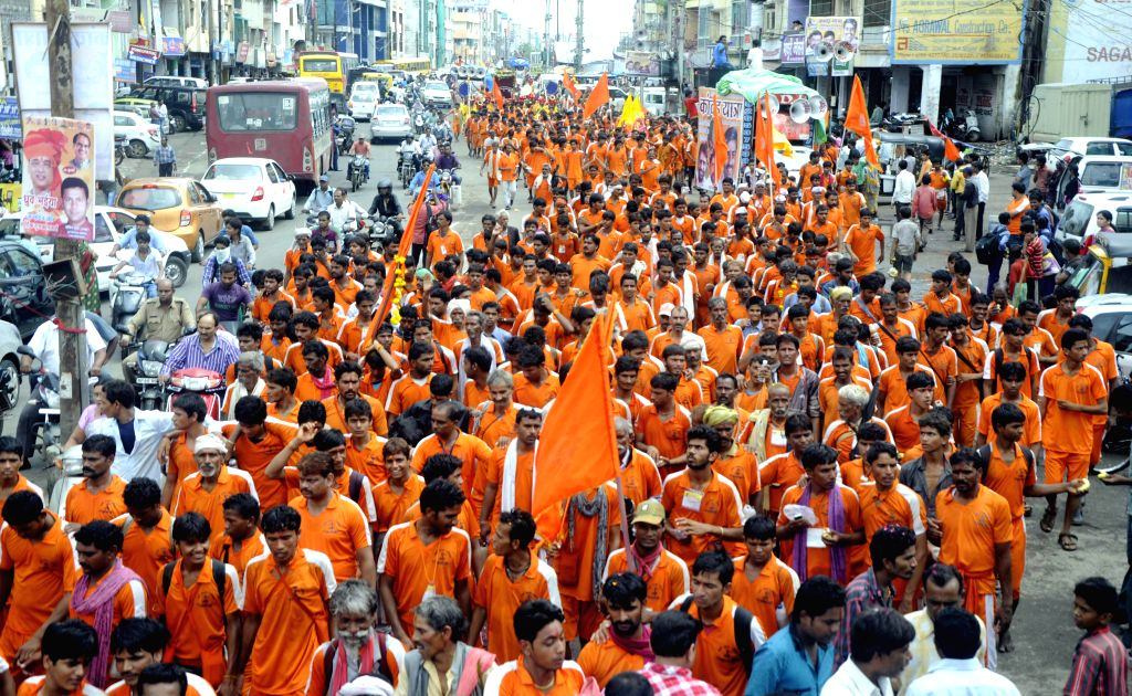 Kanwariyas (worshippers of lord Shiva) participate in a procession during the holy month of `Sawan` in Bhopal on July 28, 2014.