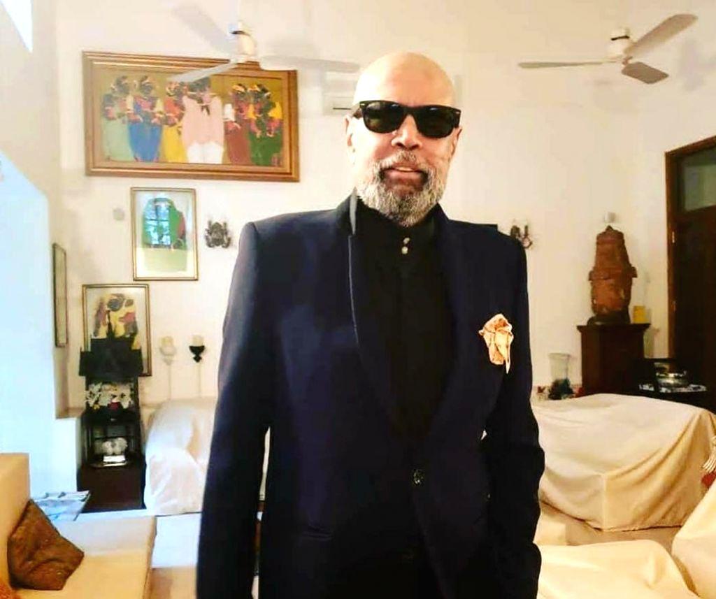Kapil Dev's new bald chic finds a fan in Anupam Kher. - Kapil Dev and Anupam Kher