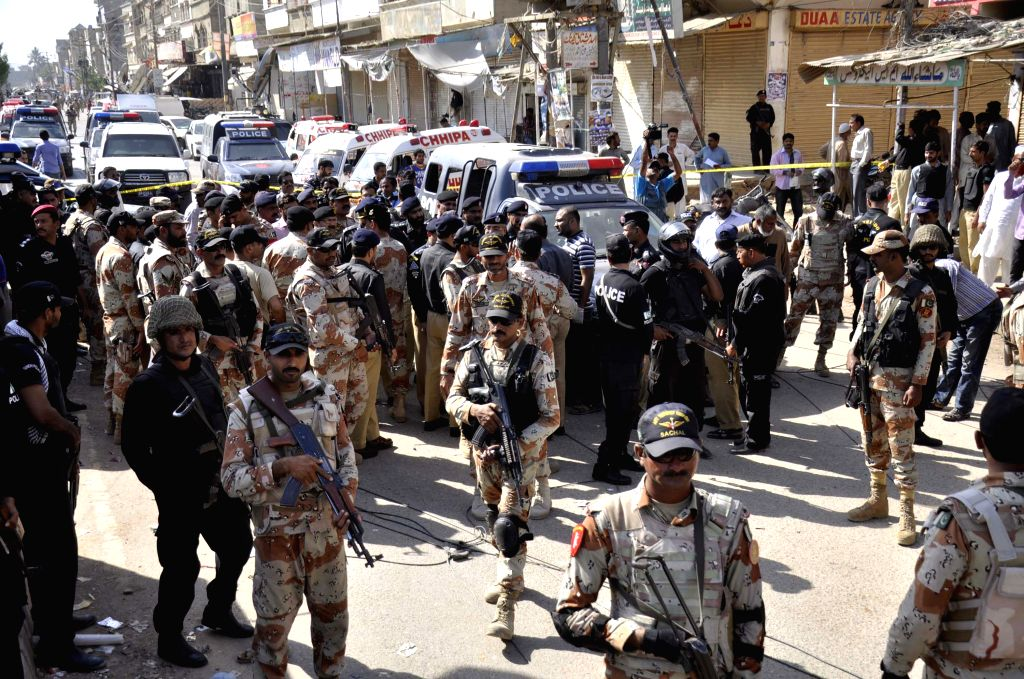 KARACHI, April 20, 2016 - Pakistani paramilitary soldiers cordon off the attack site in southern Pakistani port city of Karachi, April 20, 2016. At least seven policemen, deployed to guard ...