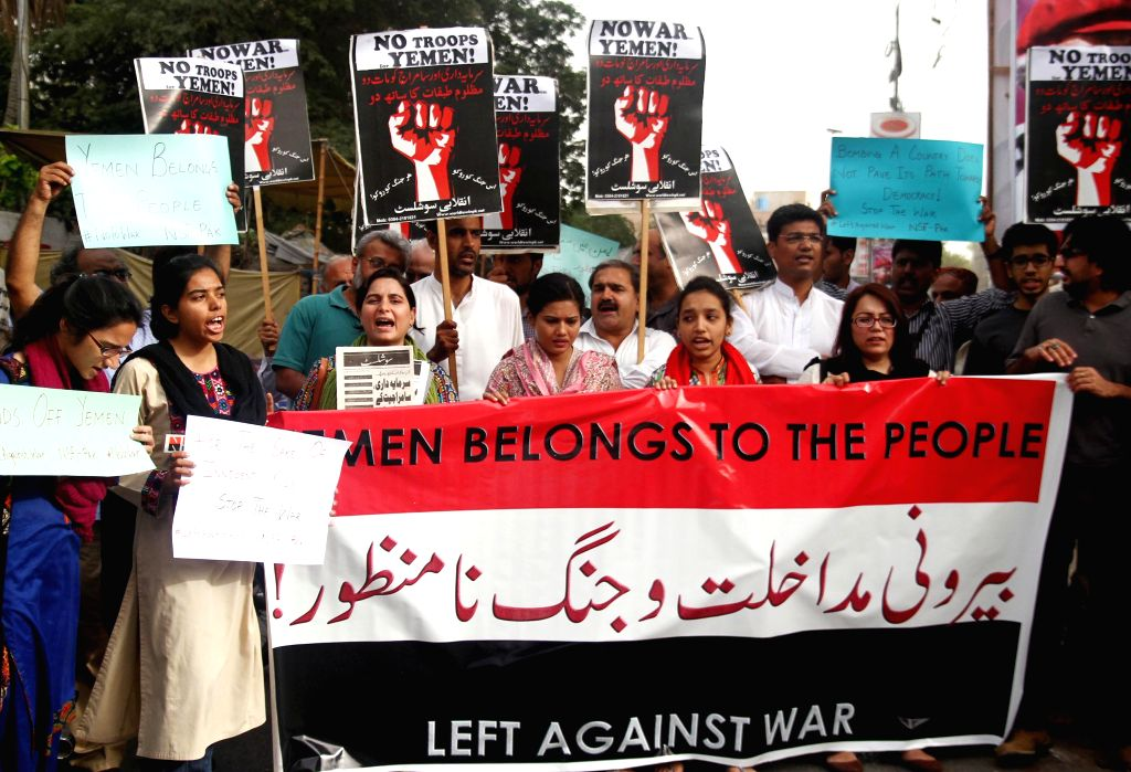 Pakistani anti-war activists hold placards and banners during a protest to condemn Saudi Arabia-led airstrikes on Yemen, in southern Pakistani port city of Karachi ...