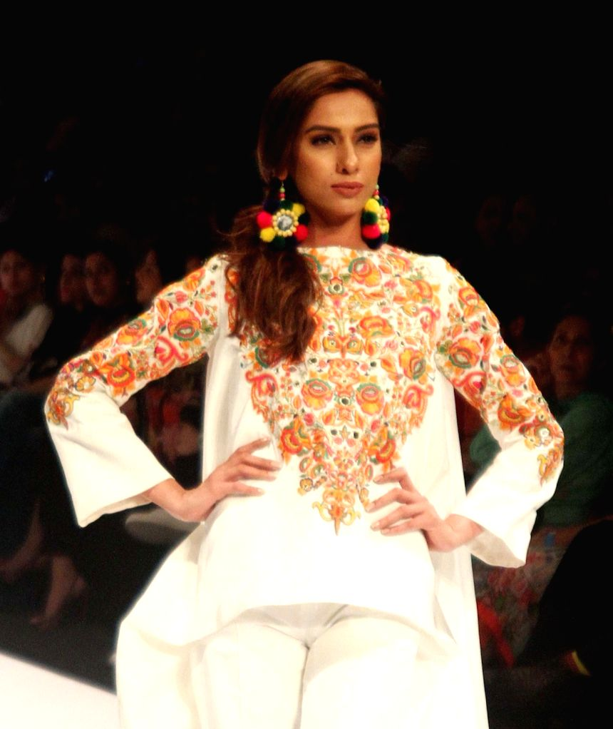 KARACHI, April 8, 2016 - A model presents a creation by designer Gul Ahmed on the second day of the Fashion Pakistan Week in Karachi on April 8, 2016.