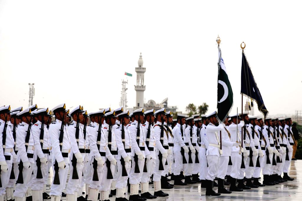 Pakistani Navy cadets march at the mausoleum of the founder of Pakistan Muhammad Ali Jinnah during a ceremony to mark Pakistan's Independence Day in southern ...