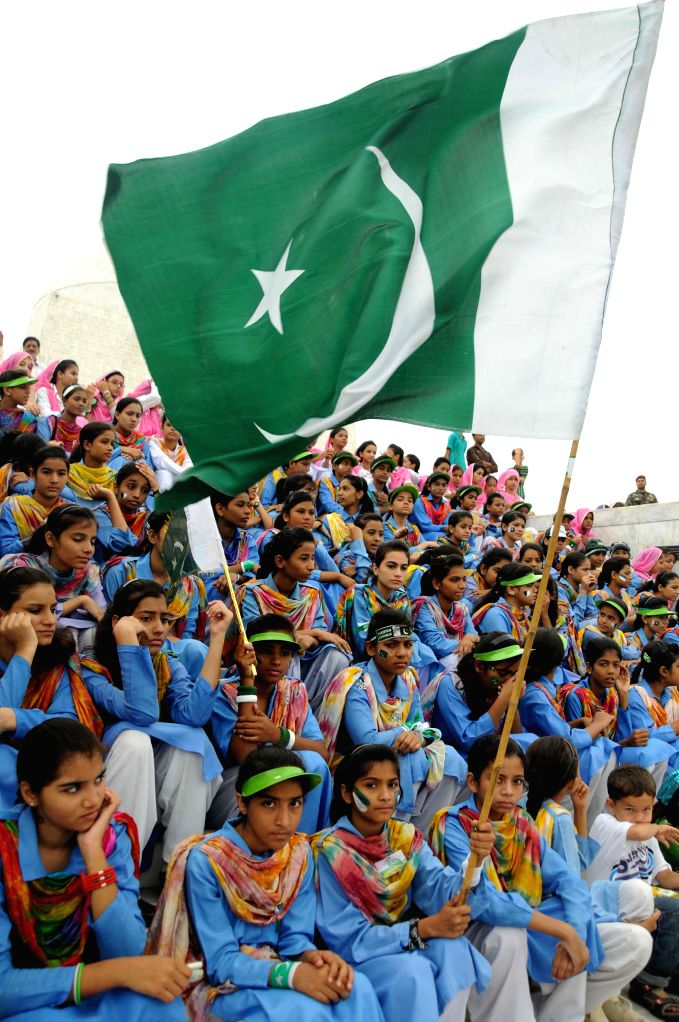 Pakistani students attend a ceremony to mark Pakistan's Independence Day at the mausoleum of the founder of Pakistan Muhammad Ali Jinnah in southern Pakistani port .