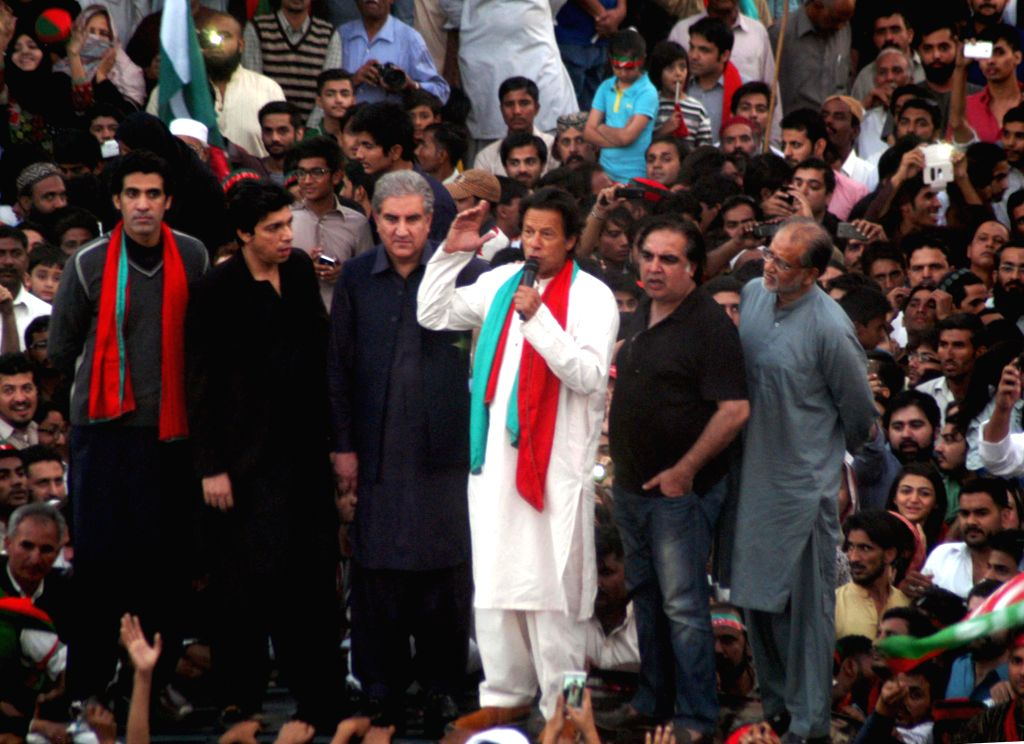 Pakistani politician Imran Khan (C) addresses his supporters during an anti-government protest in southern Pakistani port city of Karachi on Dec. 12, 2014. Pakistan