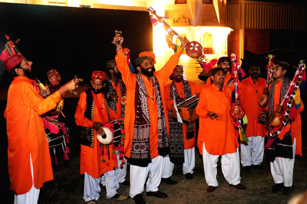 Local artists present centuries old dance at the beats of folk music at the launching ceremony of Sindh Festival in southern Pakistani port city of Karachi, on