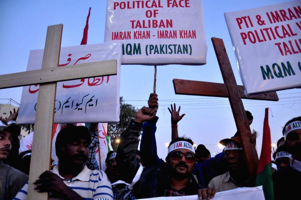 Supporters of Muttahida Qaumi Movement (MQM) attend a rally in southern Pakistani port city of Karachi on Feb. 10, 2015. The Muttahida Qaumi Movement (MQM) holds a . - Imran Khan