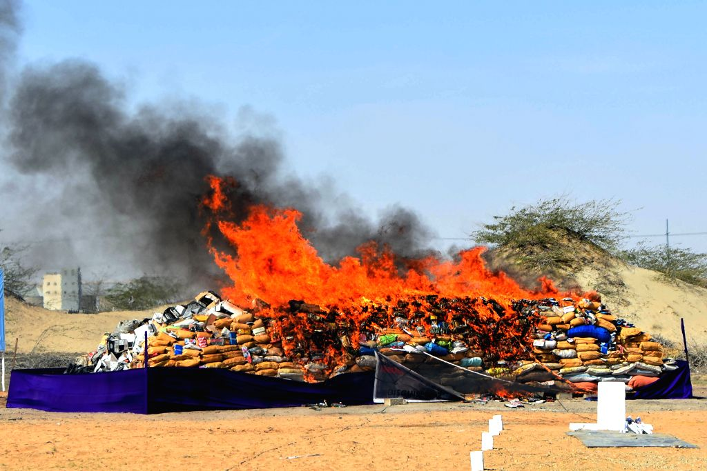 KARACHI, Feb. 12, 2019 - Drugs are burnt during a ceremony in Pakistan's southern port city of Karachi on Feb. 11, 2019. Pakistan Coast Guards on Monday destroyed tons of drugs including heroin, ...