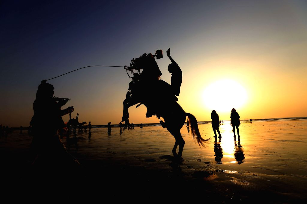 KARACHI, Jan. 26, 2019 - A tourist rides on a horse during sunset at Clifton beach in Karachi, Pakistan, on Jan. 25, 2019.