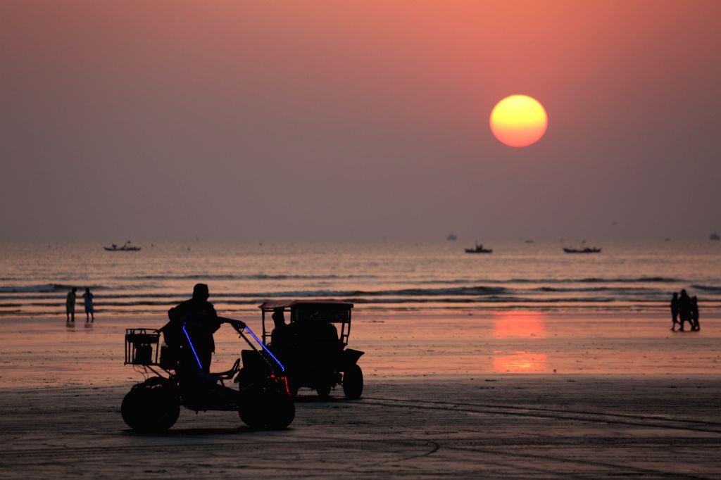 KARACHI, Jan. 26, 2019 - People enjoy sunset view at Clifton beach in Karachi, Pakistan, on Jan. 25, 2019.