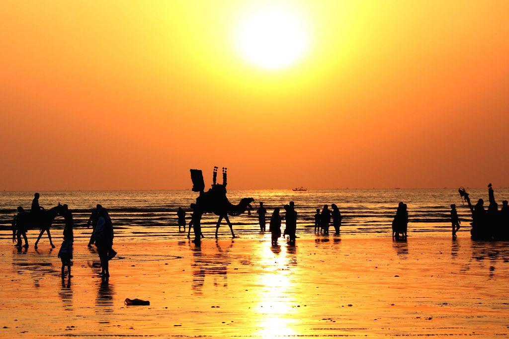 KARACHI, Jan. 26, 2019 - People visit Clifton beach during sunset in Karachi, Pakistan, on Jan. 25, 2019.