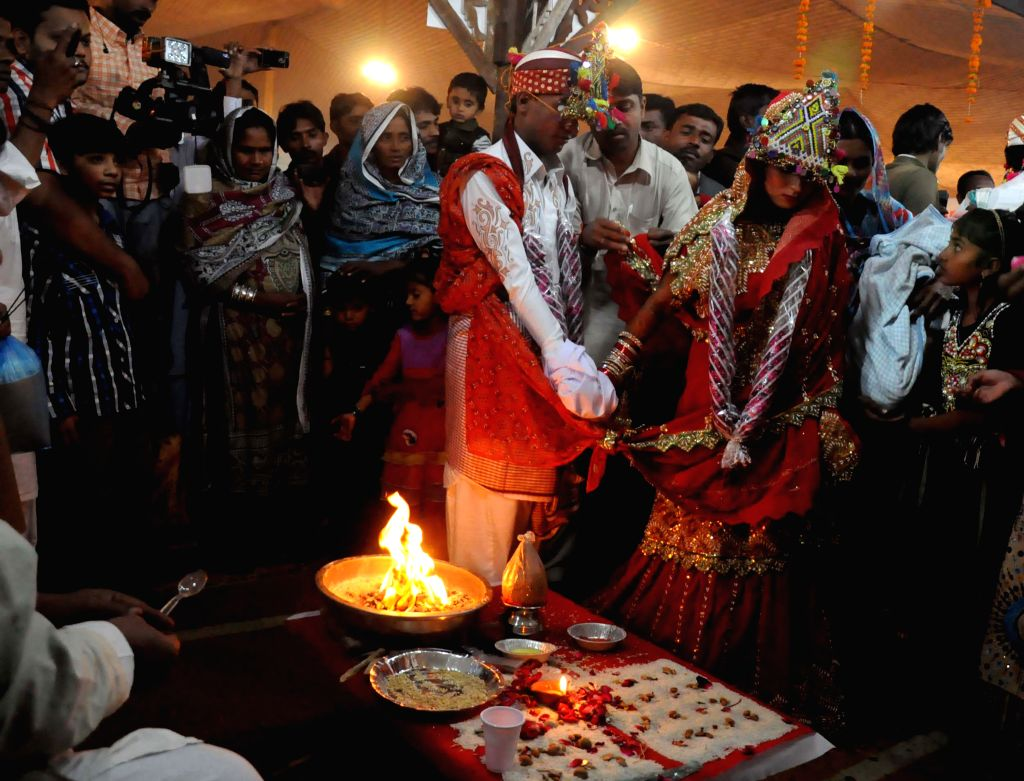 A Pakistani Hindu couple performs a Hindu ritual during a group wedding ceremony in southern Pakistani port city of Karachi, on Jan. 2, 2015. A total of 50 couples ..