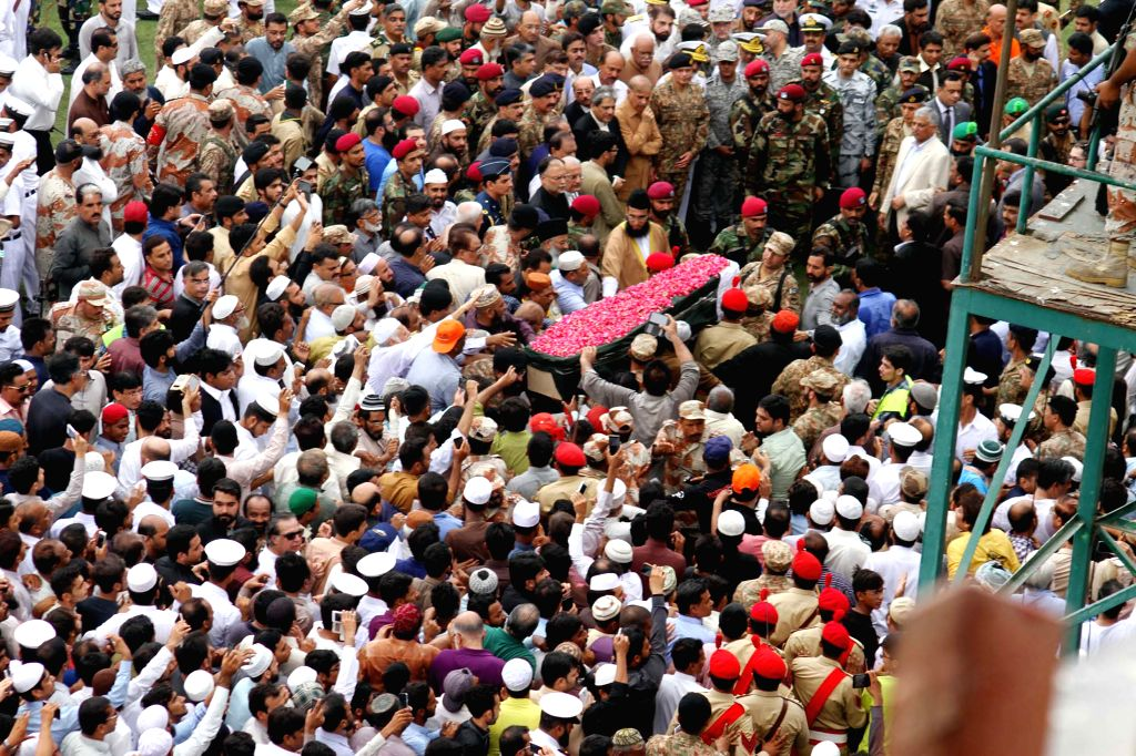 KARACHI, July 10, 2016 - Pakistani people carry the coffin of well-known Pakistani philanthropist Abdul Sattar Edhi during his funeral ceremony in southern Pakistani port city of Karachi, July 9, ...