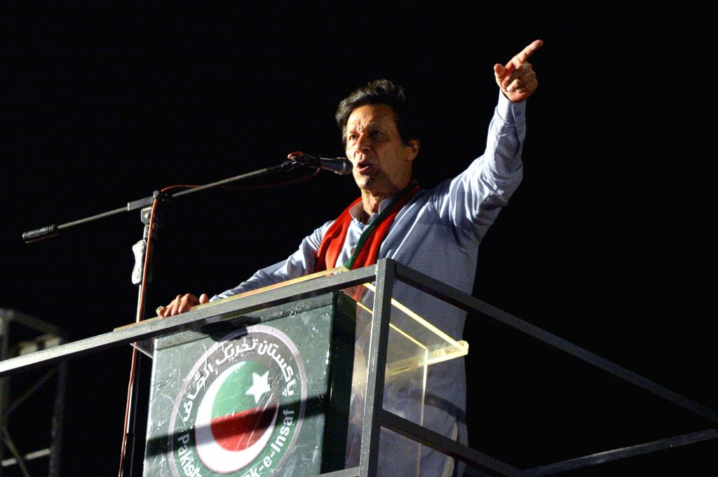 KARACHI, July 22, 2018 - Imran Khan, chief of the Pakistan Tehreek-e-Insaf (PTI) party, addresses his supporters during an election campaign rally in southern Pakistani port city of Karachi, July 22, ... - Imran Khan