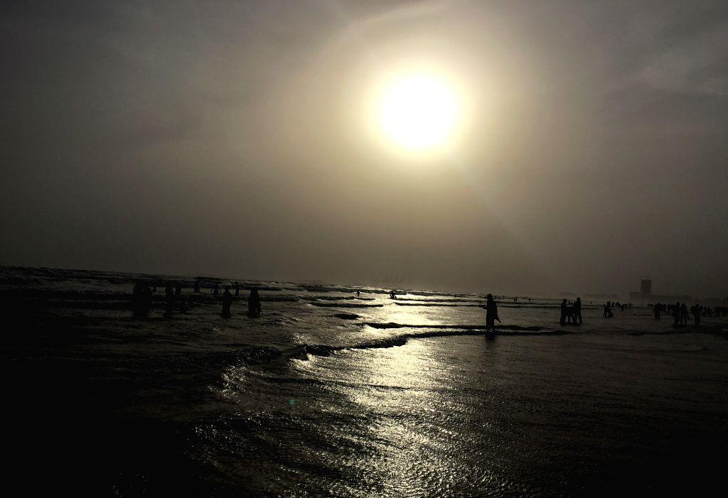 KARACHI, July 4, 2016 - People visit Clifton beach during sunset in southern Pakistani port city of Karachi on July 3, 2016.