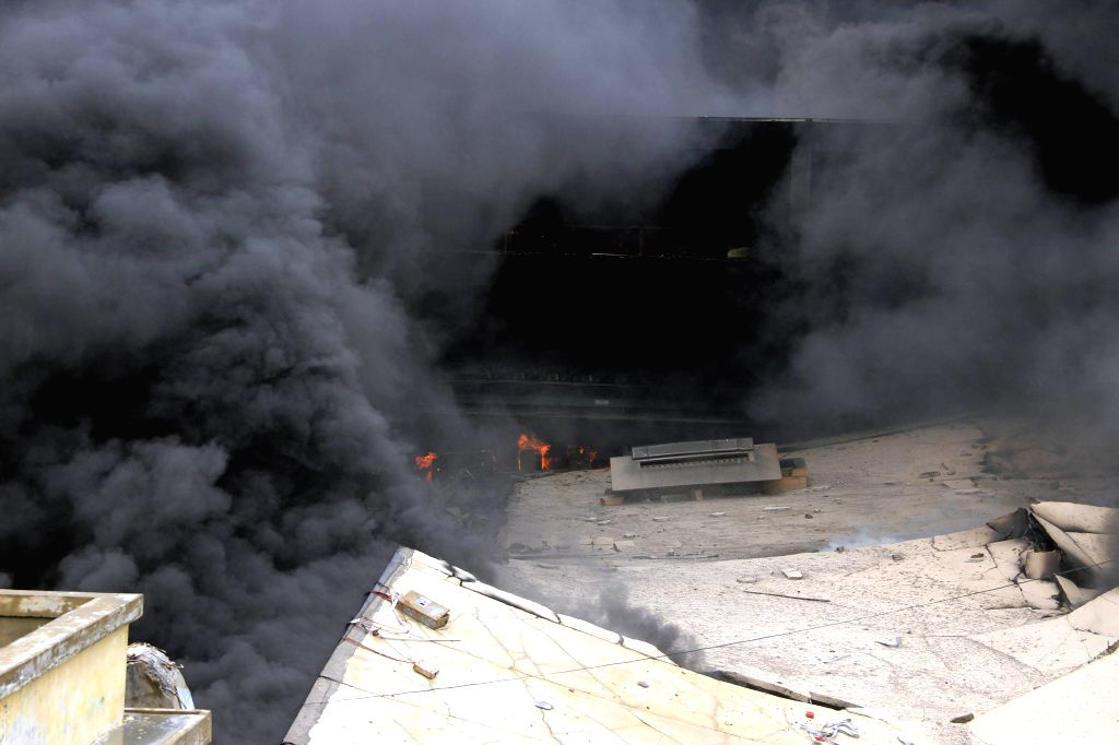 KARACHI, July 5, 2018 - Fire rages at a factory in southern Pakistani port city of Karachi on July 5, 2018. At least six firefighters were injured while battling a huge ablaze that broke out in a ...
