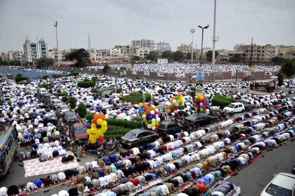 KARACHI, July 6, 2016 - Pakistani Muslims offer Eid al-Fitr prayers in southern Pakistani port city Karachi on July 6, 2016.