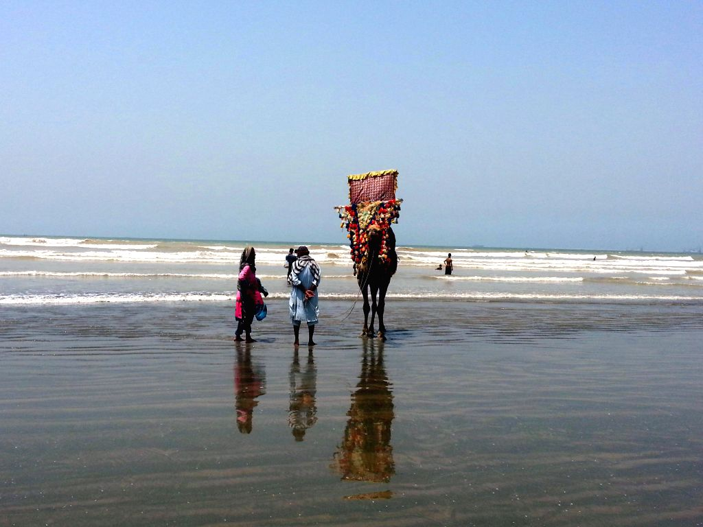 Tourists visit Clifton beach in southern Pakistani port city of Karachi, May 10, 2014.