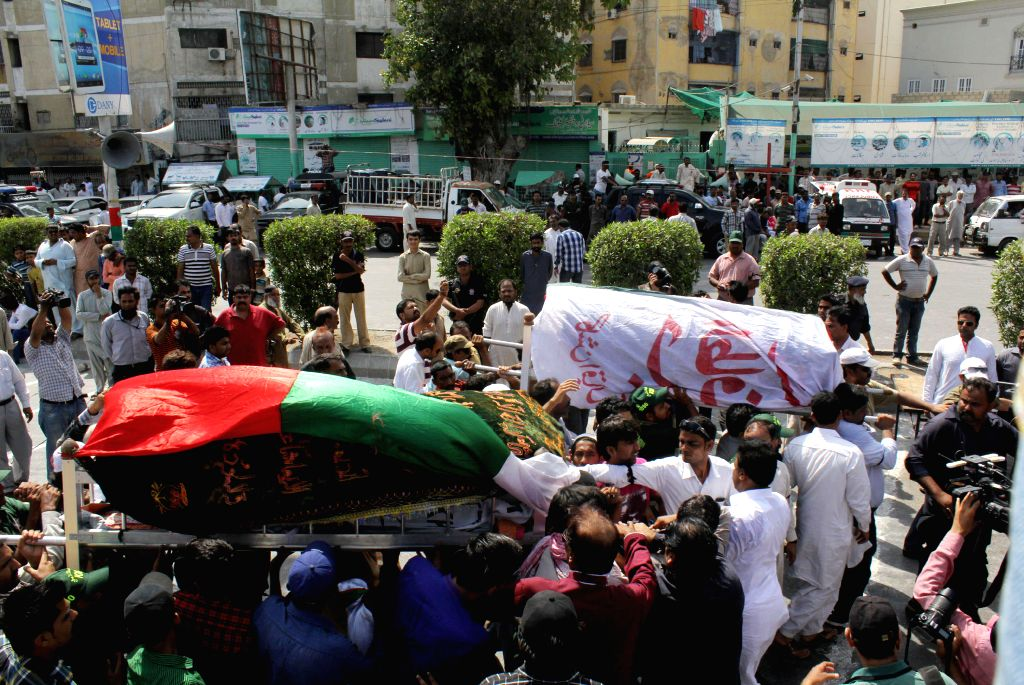 Supporters of Mutahida Qaumi Movement (MQM) party attend the funeral ceremony in southern Pakistani port city of Karachi on May 2, 2014. At least seven people were ...