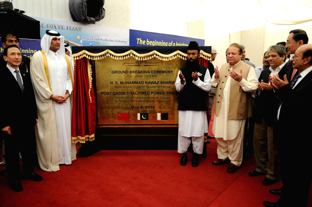 Pakistani Prime Minister Nawaz Sharif (4th L) offers prayer after unveiling the plaque of ground breaking ceremony of Port Qasim Coal Fired Power Project in southern . - Nawaz Sharif