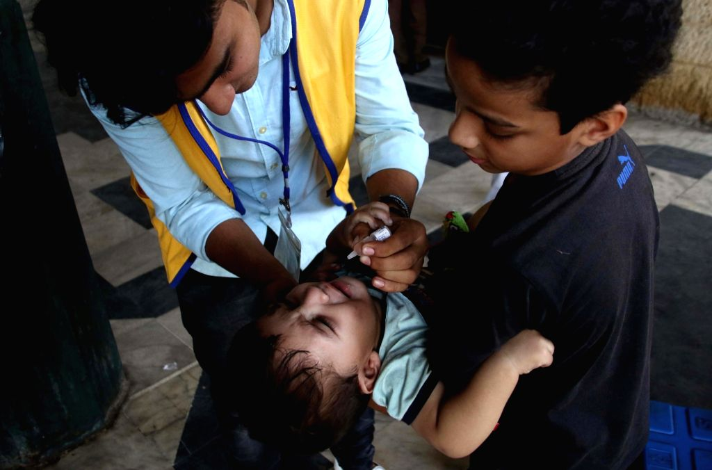 KARACHI, Oct. 24, 2017 (Xinhua) -- A health worker gives polio drops to a child on World Polio Day in southern Pakistani port city of Karachi on Oct. 24, 2017. (Xinhua/Arshad/IANS)